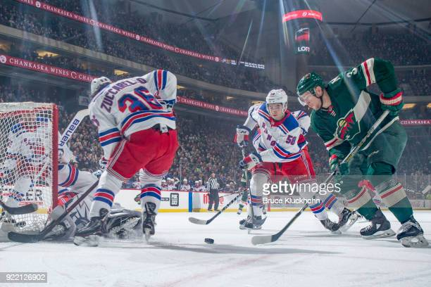 Mats Zuccarello and John Gilmour of the New York Rangers defend against Charlie Coyle of the Minnesota Wild during the game at the Xcel Energy Center...