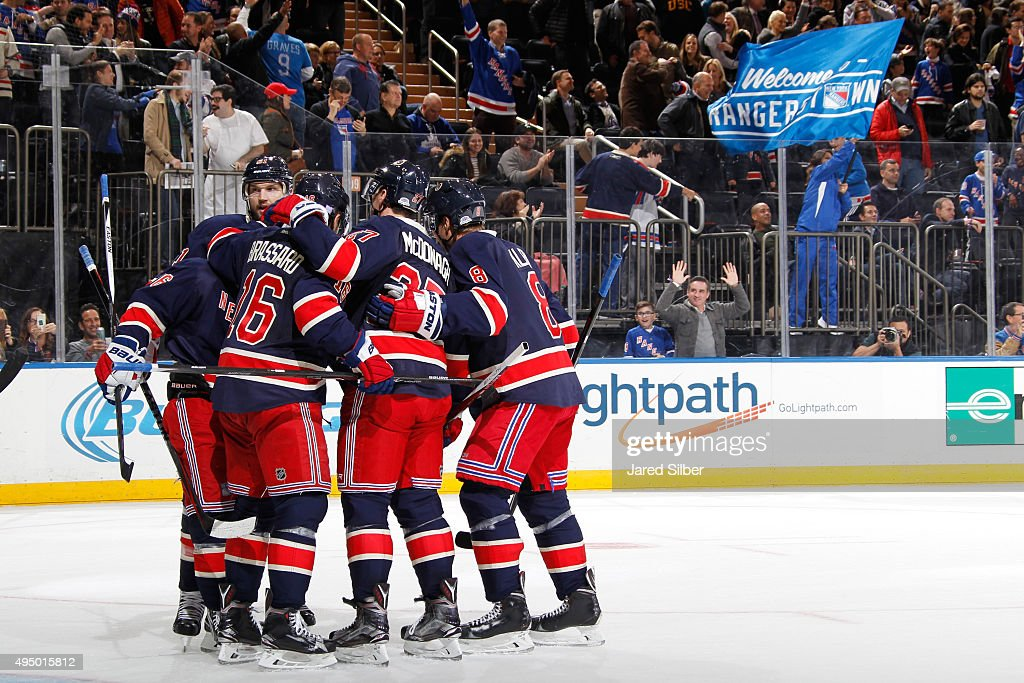 Mats Zuccarello #36, Derick Brassard #16, Rick Nash #61, Ryan McDonagh #27 and Kevin Klein #8 of the New York Rangers celebrate after a third period goal against the Toronto Maple Leafs at Madison Square Garden on October 30, 2015 in New York City.