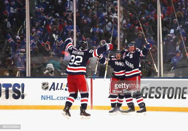 Mats Zuccarello JT Miller and Kevin Shattenkirk of the New York Rangers celebrate after Miller scored the gamewinning goal in overtime against the...