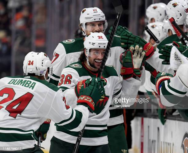 Mats Zuccarello of the Minnesota Wild celebrates his goal with Matt Dumba and Marcus Foligno to tie the game 22 with the Anaheim Ducks during the...