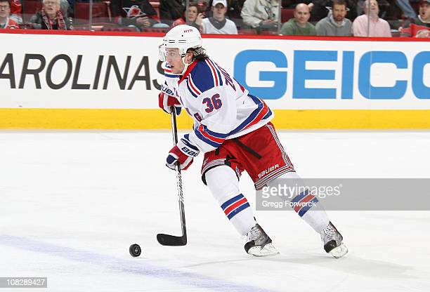 Mats Zuccarello of the New York Rangers caries the puck during a NHL game against yhe Carolina Hurricanes on January 20 2011 at RBC Center in Raleigh...