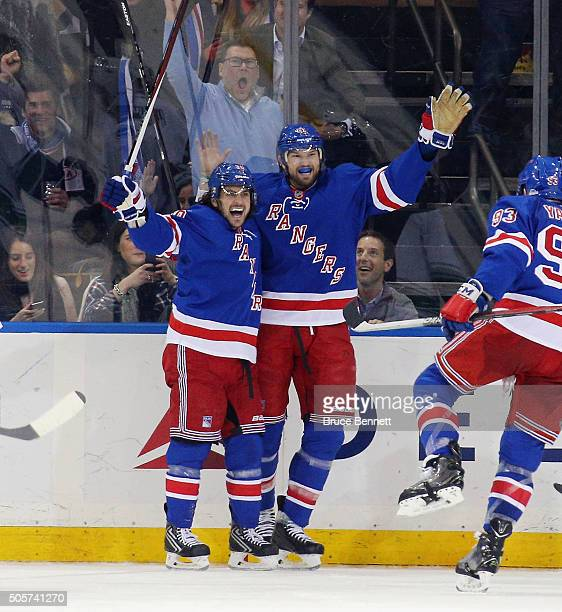 Mats Zuccarello of the New York Rangers celebrates his goal at 11:46 of the third period against the Vancouver Canucks and is joined by Rick Nash at...