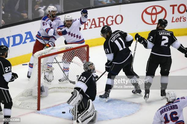 Mats Zuccarello of the New York Rangers celebrates his goal with teammate Benoit Pouliot in the first period during Game Two of the 2014 NHL Stanley...