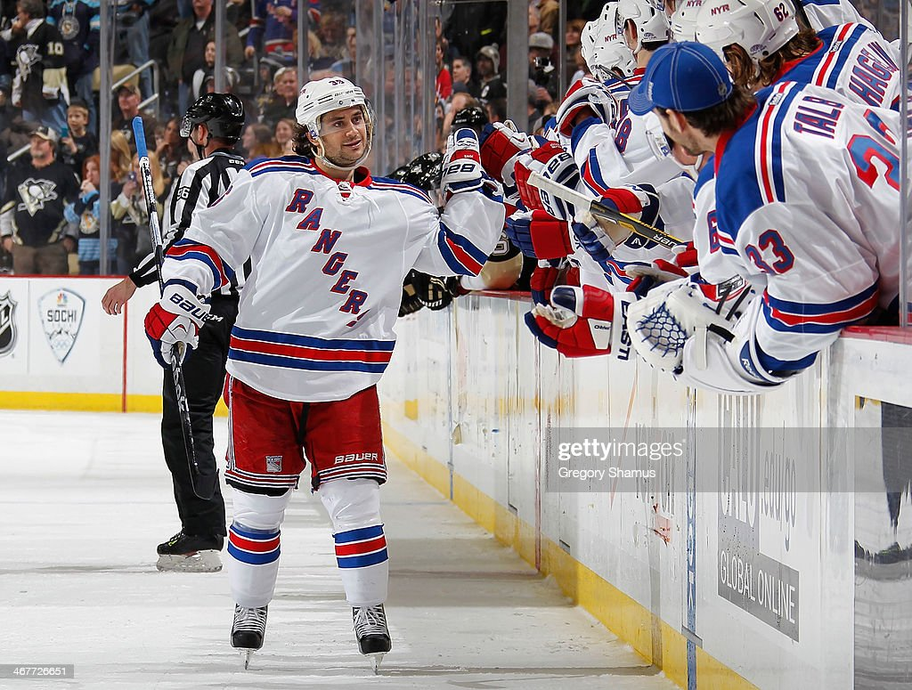 Mats Zuccarello #36 of the New York Rangers celebrates his shootout goal with the bench during the game against the Pittsburgh Penguins on February 7, 2014 at Consol Energy Center in Pittsburgh, Pennsylvania.