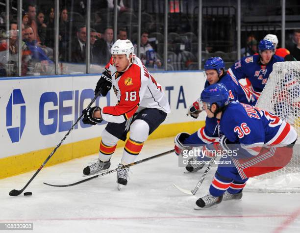 Mats Zuccarello of the New York Rangers challenges Shawn Matthias of the Florida Panthers for possession of the puck during the first period at...
