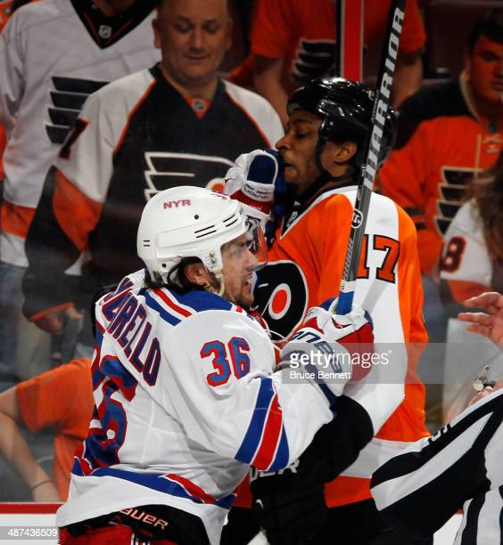 Mats Zuccarello of the New York Rangers gets the glove up on Wayne Simmonds of the Philadelphia Flyers in Game Six of the First Round of the 2014 NHL...