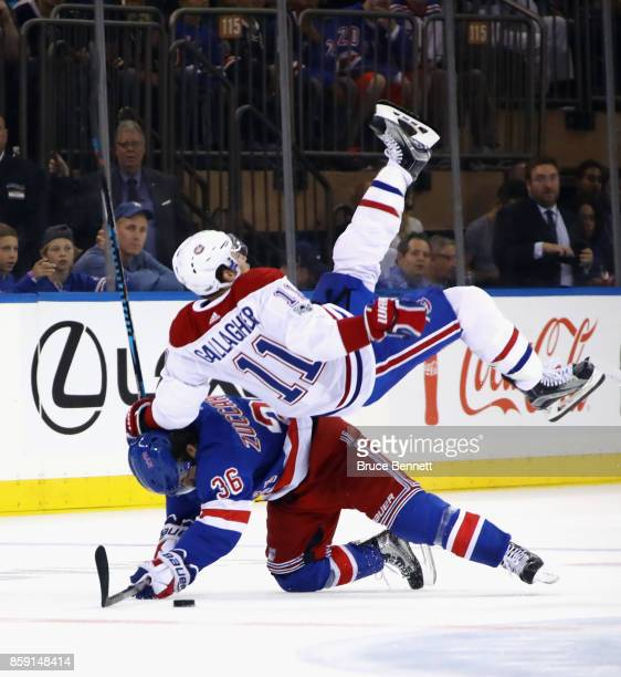 Mats Zuccarello of the New York Rangers gets under Brendan Gallagher of the Montreal Canadiens during a first period check at Madison Square Garden...