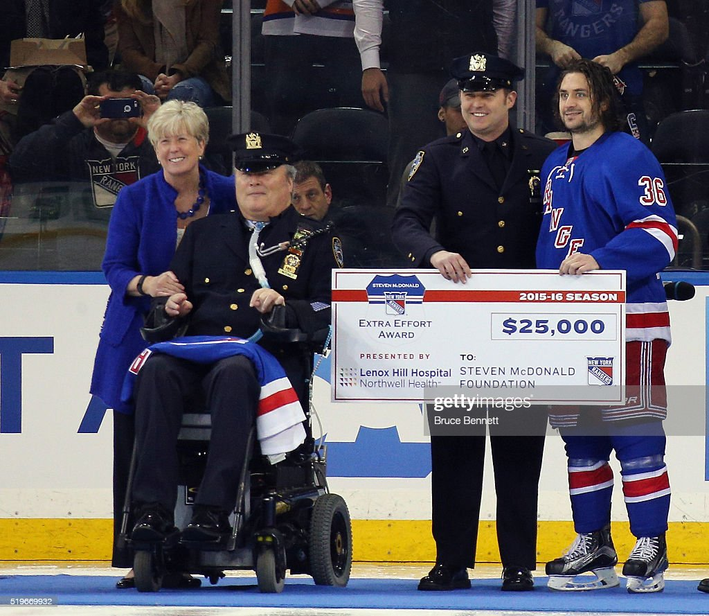Mats Zuccarello #36 of the New York Rangers is awarded the Steven McDonald Award prior to the game against the New York Islanders at Madison Square Garden on April 7, 2016 in New York City.