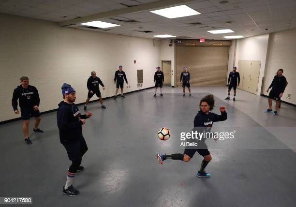 Mats Zuccarello of the New York Rangers kicks a soccer ball with his teamates prior to their game against the New Jersey Devils at Madison Square...