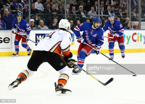 Mats Zuccarello of the New York Rangers skates against Cam Fowler of the Anaheim Ducks during their game at Madison Square Garden on December 19 2017...