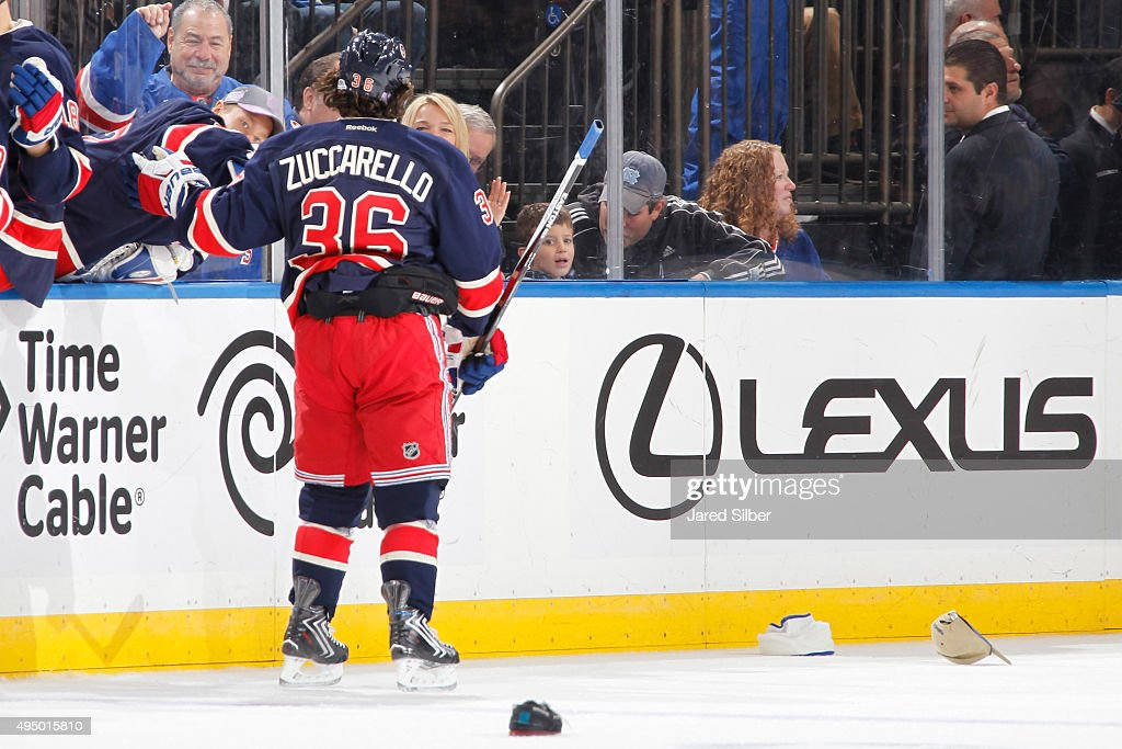 Mats Zuccarello #36 of the New York Rangers skates past hats on the ice after scoring his third goal of the game for a hat trick in the third period against the Toronto Maple Leafs at Madison Square Garden on October 30, 2015 in New York City.