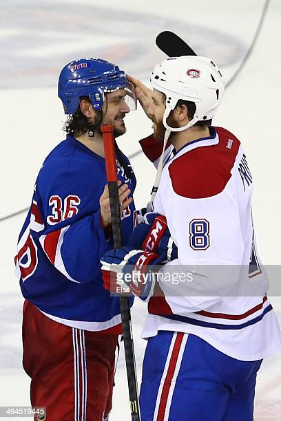 Mats Zuccarello of the New York Rangers talks with Brandon Prust of the Montreal Canadiens after defeating the Montreal Canadiens in Game Six to win...