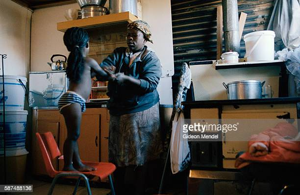 Matshaidiso Madondo an HIVpositive 29yearold widow whose husband died from AIDSrelated infections rubs Vaseline onto her 3yearold daughter Hazel...