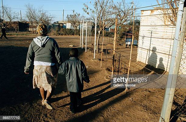Matshaidiso Madondo an HIVpositive 29yearold widow whose husband died from AIDSrelated infections walks her 5yearold son Siphisihle to school in the...