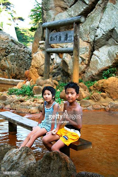 Matsugashita hot springs Shikinejima Kids at Matsugashita hot spring's foot bath The rest of the reddish water is a tad too hot for the whole body...