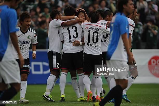 Matsumoto Yamaga players celebrate the first goal during the JLeague second division match between Yokohama FC and Matsumoto Yamaga at Ajinomoto...