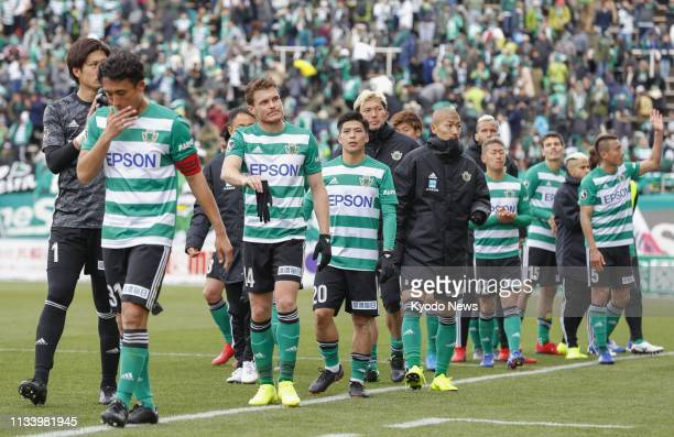 Matsumoto Yamaga players leave the pitch after a 2-0 loss to Kawasaki Frontale in a J-League football match in Matsumoto, Japan, on March 31, 2019....