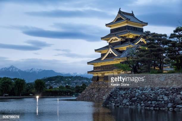 Matsumotojo castle in Matsumoto at dusk, Japan.