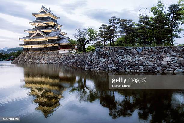 Matsumotojo castle in Matsumoto at dusk, Japan with a reflection.