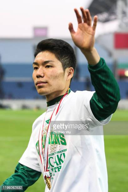 Matsumura Yuta of Shizuoka Gakuen attends the award ceremony and celebrates the champion with classmates after the 98th All Japan High School Soccer...