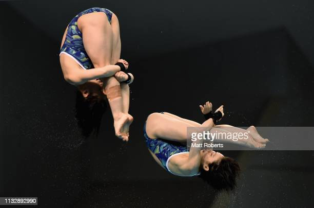 Matsuri Arai and Minami Itahashi of Japan compete during the Women's 10m Synchro Platform Final on day one of the FINA Diving World Cup Sagamihara at...