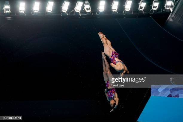 Matsuri Arai And Minami Itahashi of Japan perform in the women's synchronised 10m platform event during on day ten of the Asian Games on August 28,...