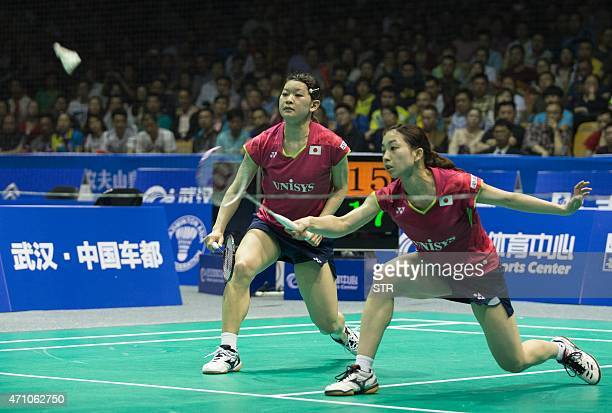 Matsutomo Misaki and Takahashi Ayaka of Japan return to Wang Xiaoli and Yu Yang of China during their women's doubles semi final match at the...