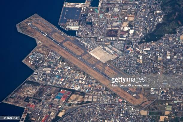 Matsuyama Airport in Matsuyama city in Ehime prefecture in Japan daytime aerial view from airplane