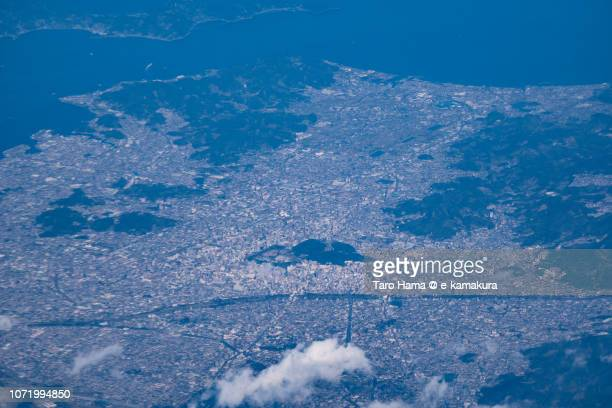 Matsuyama city in Ehime prefecture and Seto Inland Sea in Japan daytime aerial view from airplane