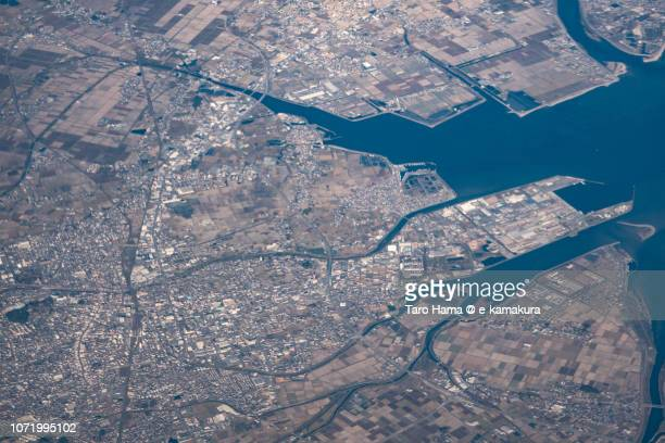 Matsuzaka city in Mie prefecture in Japan daytime aerial view from airplane