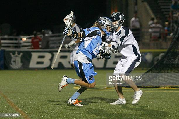 Matt Abbott of the Chesapeake Bayhawks defends against Connor Martin of the Ohio Machine on July 21 2012 at Selby Stadium in Delaware Ohio