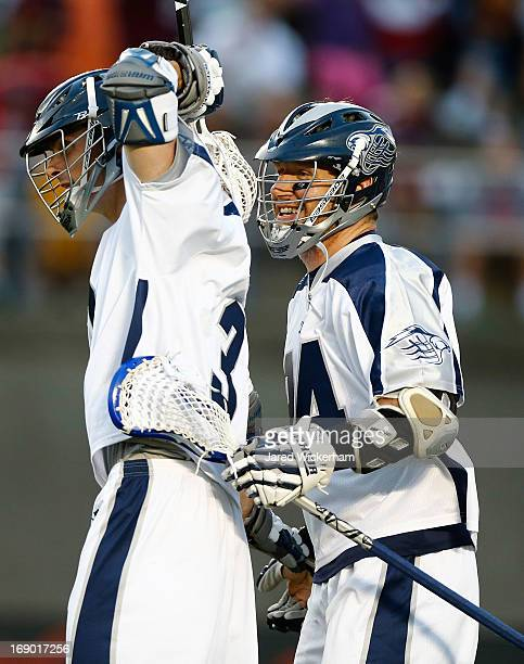 Matt Abbott of the Chesapeake Baykawks celebrates with teammate John Grant Jr following a goal in the first half against the Boston Cannons during...