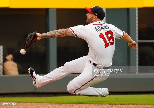 Matt Adams of the Atlanta Braves fails to catch this double hit by Cesar Hernandez of the Philadelphia Phillies to lead off the first inning at...