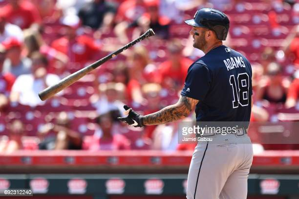Matt Adams of the Atlanta Braves reacts after striking out to end the fourth inning against the Cincinnati Reds at Great American Ball Park on June 4...