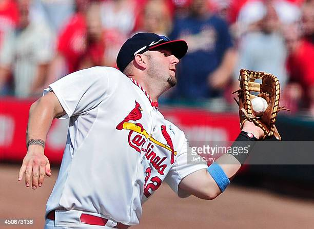 Matt Adams of the St Louis Cardinals catches a fly ball during the ninth inning against the Washington Nationals at Busch Stadium on June 15 2014 in...
