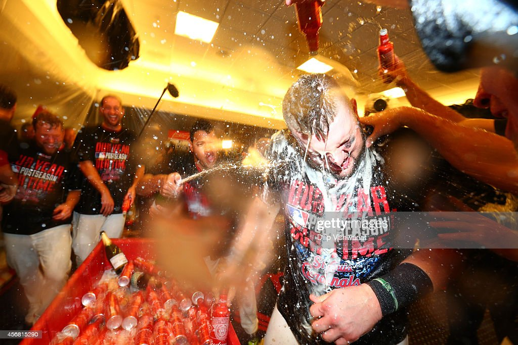 Matt Adams #32 of the St. Louis Cardinals celebrates in the locker room with teammates after defeating the Los Angeles Dodgers 3-2 in Game Four of the National League Divison Series at Busch Stadium on October 7, 2014 in St Louis, Missouri.