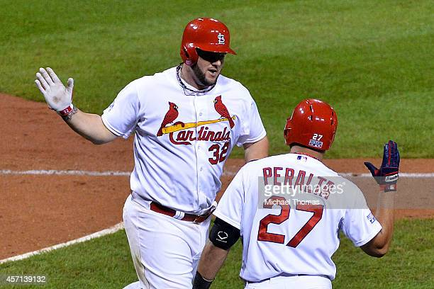 Matt Adams of the St Louis Cardinals celebrates with Jhonny Peralta after hitting a solo home run in the eighth inning against the San Francisco...