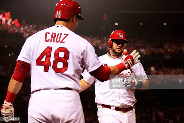 Matt Adams of the St Louis Cardinals celebrates with Tony Cruz after hitting a solo home run in the eighth inning against the San Francisco Giants...