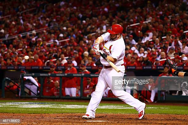 Matt Adams of the St Louis Cardinals hits a solo home run in the eighth inning against the San Francisco Giants during Game Two of the National...
