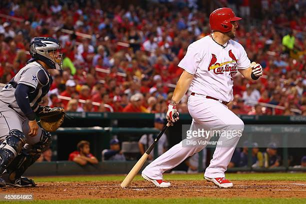 Matt Adams of the St Louis Cardinals hits a twoRBI single against the San Diego Padres in the first inning at Busch Stadium on August 15 2014 in St...