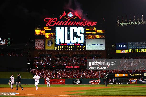 Matt Adams of the St Louis Cardinals runs the bases after hitting a solo home run in the eighth inning against the San Francisco Giants during Game...
