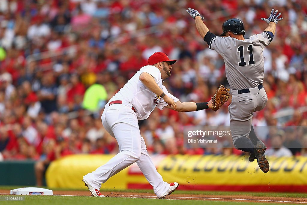 Matt Adams #32 of the St. Louis Cardinals tags Brett Gardner #11 of the New York Yankees for out in the first inning at Busch Stadium on May 27, 2014 in St. Louis, Missouri. Photo by Dilip Vishwanat/Getty Images)