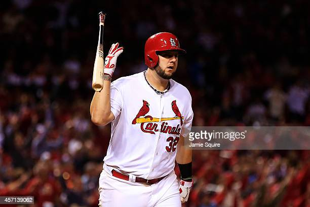 Matt Adams of the St. Louis Cardinals tosses his bat after hitting a solo home run in the eighth inning against the San Francisco Giants during Game...
