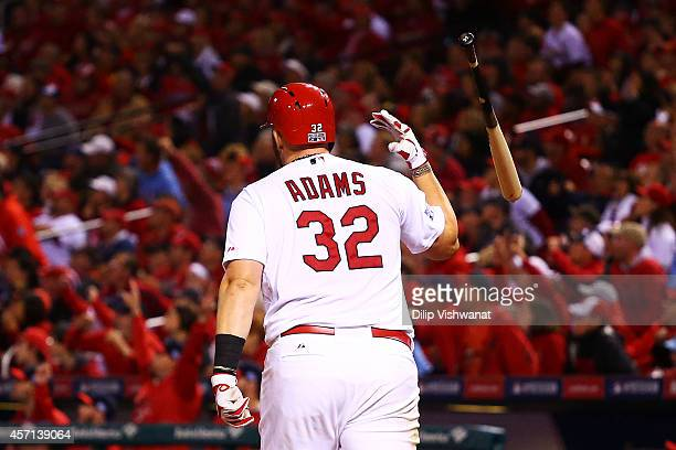 Matt Adams of the St Louis Cardinals tosses his bat after hitting a solo home run in the eighth inning against the San Francisco Giants during Game...