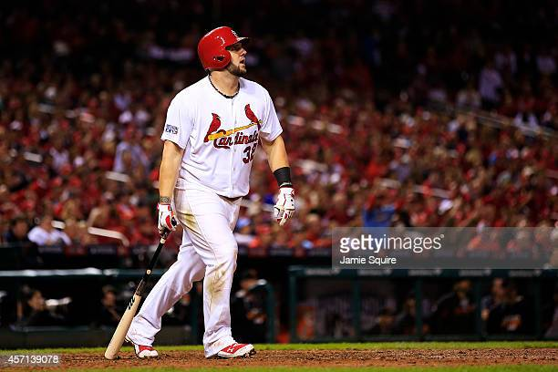 Matt Adams of the St Louis Cardinals watches his solo home run in the eighth inning against the San Francisco Giants during Game Two of the National...