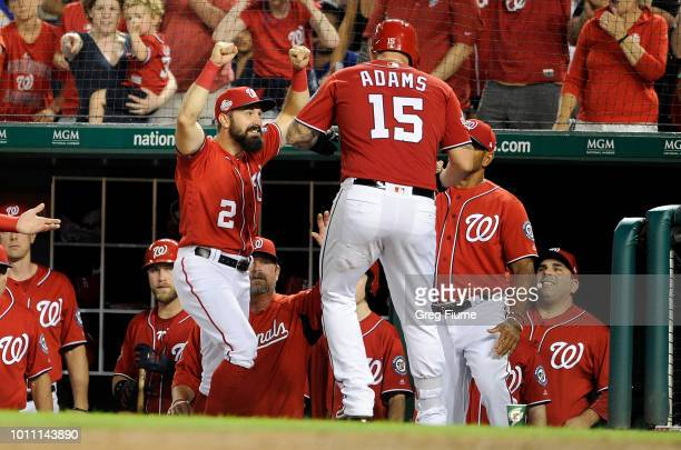 Matt Adams of the Washington Nationals celebrates with Adam Eaton after hitting a home run in the fifth inning against the Cincinnati Reds during...