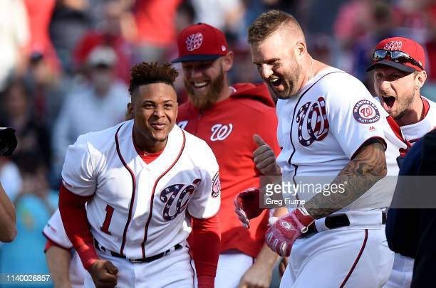 Matt Adams of the Washington Nationals celebrates with teammates after hitting the gamewinning home run in the 11th inning against the San Diego...