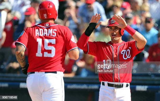 Matt Adams of the Washington Nationals is congratulated by Matt Reynolds after he hit a tworun home run against the New York Mets in the fifth inning...