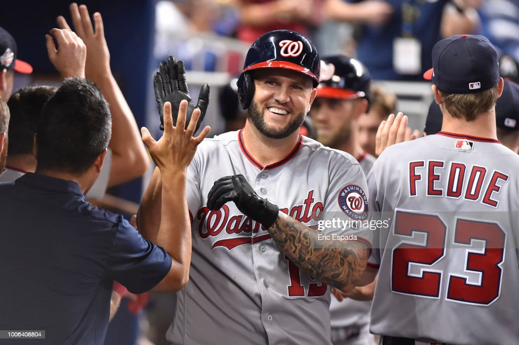 Matt Adams #15 of the Washington Nationals is congratulated by teammates after scoring in the eighth inning against the Miami Marlins at Marlins Park on July 27, 2018 in Miami, Florida.