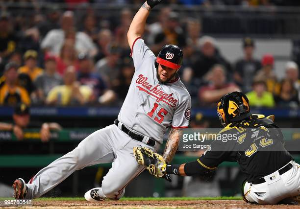 Matt Adams of the Washington Nationals is tagged out by Elias Diaz of the Pittsburgh Pirates at the plate during the seventh inning at PNC Park on...